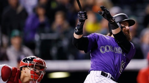 Colorado Rockies' Charlie Blackmon, right, follows the flight of his two-run home run with Washington Nationals catcher Jose Lobaton in the seventh inning of a baseball gam,e Monday, April 24, 2017, in Denver. (AP Photo/David Zalubowski)