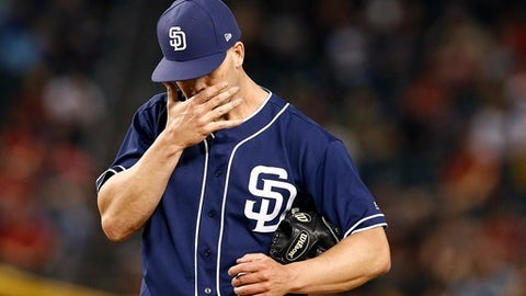 San Diego Padres' Clayton Richard pauses on the mound after giving up a two-run triple to Arizona Diamondbacks' Chris Owings during the second inning of a baseball game Tuesday, April 25, 2017, in Phoenix. (AP Photo/Ross D. Franklin)