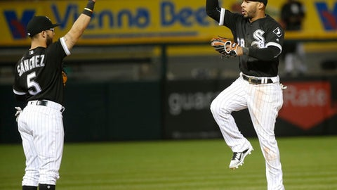 Chicago White Sox's Yolmer Sanchez (5) and Leury Garcia celebrate the White Sox's 10-5 win over the Kansas City Royals after a baseball game, Tuesday, April 25, 2017, in Chicago. (AP Photo/Charles Rex Arbogast)