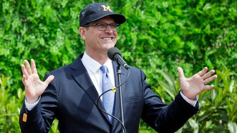 Michigan head football coach Jim Harbaugh talks to journalists during a press conference, in Rome, Wednesday, April 26, 2017. Michigan's NCAA college football team arrived in Rome last weekend and kicked off the unique trip by meeting with refugees before going to the Vatican for a Papal address before practicing a few times. (AP Photo/Andrew Medichini)