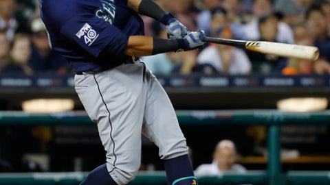 Seattle Mariners' Nelson Cruz hits a two-run home run against the Detroit Tigers in the sixth inning of a baseball game in Detroit, Wednesday, April 26, 2017. (AP Photo/Paul Sancya)