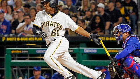 Pittsburgh Pirates' Gift Ngoepe, a native of South Africa, and the first baseball player from the continent of Africa to play in the Major Leagues, hits a single off Chicago Cubs starting pitcher Jon Lester in his first at-bat in the fourth inning of a baseball game in Pittsburgh, Wednesday, April 26, 2017. (AP Photo/Gene J. Puskar)