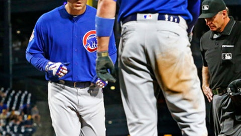 Chicago Cubs' Anthony Rizzo, left, is greeted by Kris Bryant (17) as he crosses home plate after hitting a two-run home run off Pittsburgh Pirates starting pitcher Daniel Hudson in the eighth inning of a baseball game in Pittsburgh, Wednesday, April 26, 2017. (AP Photo/Gene J. Puskar)