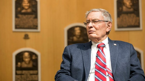 In this photo provided by the National Baseball Hall of Fame and Museum, former Major League Baseball Commissioner Bud Selig listens while touring the Hall of Fame during his orientation visit, Thursday, April 27, 2017, in Cooperstown, N.Y. Selig will be inducted to the Hall of Fame during the summer of 2017. (Milo Stewart Jr./National Baseball Hall of Fame and Museum via AP)