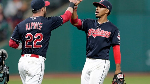 Cleveland Indians' Francisco Lindor, right, and Jason Kipnis celebrate after the Indians defeated the Houston Astros 4-3 in a baseball game, Thursday, April 27, 2017, in Cleveland. (AP Photo/Tony Dejak)