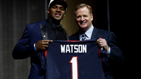 Clemson's Deshaun Watson, left, poses with NFL commissioner Roger Goodell after being selected by the Houston Texans during the first round of the 2017 NFL football draft, Thursday, April 27, 2017, in Philadelphia. (AP Photo/Matt Rourke)