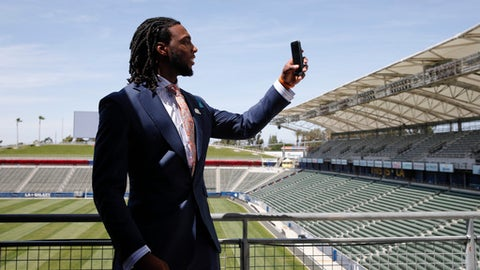Los Angeles Chargers first-round draft pick Mike Williams records video for Snapchat after an NFL football news conference at the StubHub Center, Friday, April 28, 2017, in Carson, Calif. (AP Photo/Jae C. Hong)