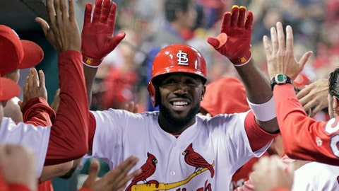 St. Louis Cardinals' Dexter Fowler celebrates with teammates after hitting a two-run home run in the third inning of a baseball game against the Cincinnati Reds, Friday, April 28, 2017, in St. Louis. (AP Photo/Tom Gannam)