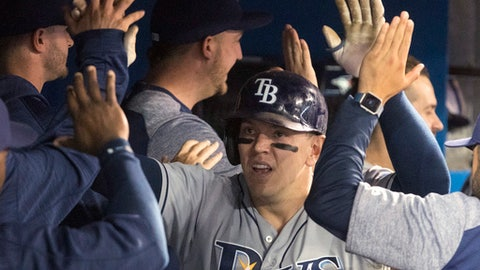 Tampa Bay Rays' Logan Morrison celebrates his two-run home run against the Toronto Blue Jays DURING the eighth inning of a baseball game in Toronto on Friday, April 28, 2017. (Fred Thornhill/The Canadian Press via AP)