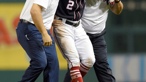 Washington Nationals' Adam Eaton (2) is carried off the field after he was injured during the ninth inning of a baseball game against the New York Mets, Friday, April 28, 2017, in Washington. (AP Photo/Nick Wass)