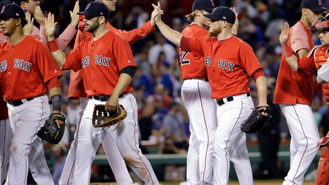 Boston Red Sox closer Craig Kimbrell, second from right, celebrates with teammates after they defeated the Chicago Cubs 5-4 in a baseball game at Fenway Park, Friday, April 28, 2017, in Boston. (AP Photo/Elise Amendola)