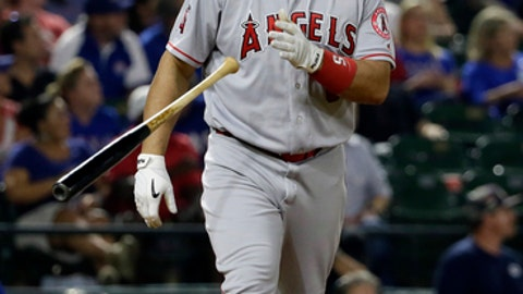 Los Angeles Angels' Albert Pujols tosses his bat as he heads to first after hitting a three-run home run off a pitch from Texas Rangers' Jeremy Jeffress in the eighth inning of a baseball game in Arlington, Texas, Friday, April 28, 2017. The shot scored Mike Trout and Kole Calhoun. (AP Photo/Tony Gutierrez)
