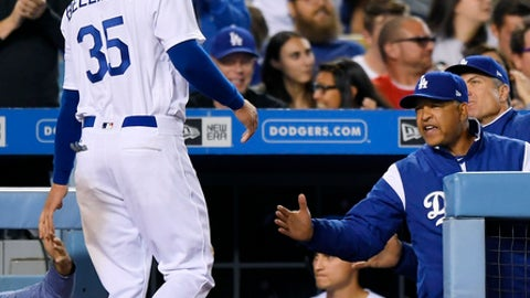 Los Angeles Dodgers' Cody Bellinger, left, is congratulated by manager Dave Roberts after scoring on a double by Enrique Hernandez during the fourth inning of a baseball game, Friday, April 28, 2017, in Los Angeles. (AP Photo/Mark J. Terrill)
