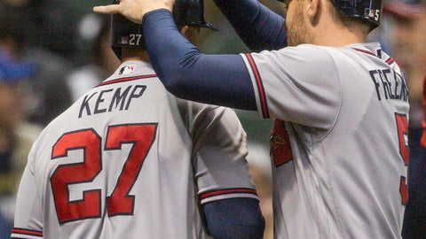 Atlanta Braves' Matt Kemp has his helmet tapped by teammate Freddie Freeman after hitting his third home run of a baseball game against the Milwaukee Brewers during the eighth inning Saturday, April 29, 2017, in Milwaukee. (AP Photo/Tom Lynn)