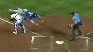 WATCH: Blue Jays player hurdles Molina to score a run