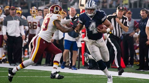 Nov 24, 2016; Arlington, TX, USA; Dallas Cowboys quarterback Dak Prescott (4) stiff arms Washington Redskins strong safety Donte Whitner Sr (39) during the game at AT&T Stadium. The Cowboys defeat the Redskins 31-26. Mandatory Credit: Jerome Miron-USA TODAY Sports