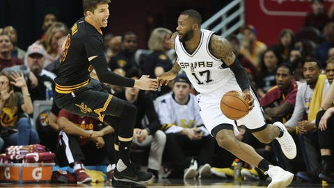 Jan 21, 2017; Cleveland, OH, USA; San Antonio Spurs guard Jonathon Simmons (17) drives to the basket against Cleveland Cavaliers guard Kyle Korver (26) during the first half at Quicken Loans Arena. Mandatory Credit: Ken Blaze-USA TODAY Sports
