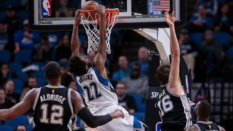 Mar 21, 2017; Minneapolis, MN, USA; Minnesota Timberwolves guard Andrew Wiggins (22) dunks in the fourth quarter against the San Antonio Spurs at Target Center. The San Antonio Spurs beat the Minnesota Timberwolves 100-93. Mandatory Credit: Brad Rempel-USA TODAY Sports