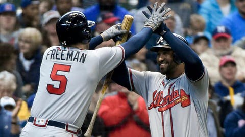 Apr 30, 2017; Milwaukee, WI, USA; Atlanta Braves first baseman Freddie Freeman (5) is greeted by left fielder Matt Kemp (27) after hitting a solo home run in the sixth inning against the Milwaukee Brewers at Miller Park. Mandatory Credit: Benny Sieu-USA TODAY Sports