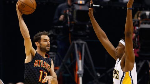 Apr 12, 2017; Indianapolis, IN, USA; Atlanta Hawks guard Jose Calderon (13) makes a pass against Indiana Pacers center Myles Turner (33) at Bankers Life Fieldhouse. Mandatory Credit: Brian Spurlock-USA TODAY Sports