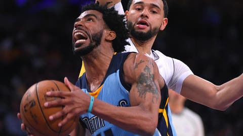 Apr 2, 2017; Los Angeles, CA, USA; Memphis Grizzlies guard Mike Conley (11) gets past Los Angeles Lakers guard Tyler Ennis (11) as he drives to the basket in the first half of the game at Staples Center. Mandatory Credit: Jayne Kamin-Oncea-USA TODAY Sports