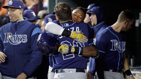 Tampa Bay Rays' Tim Beckham hugs teammate Steven Souza Jr. after hitting a solo home run in the third inning of a baseball game against the Baltimore Orioles in Baltimore, Wednesday, April 26, 2017. (AP Photo/Patrick Semansky)