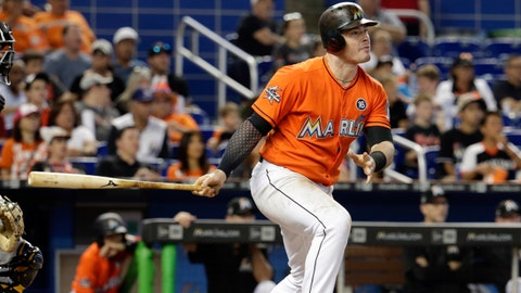 Miami Marlins' Justin Bour watches after hitting an RBI-single to score Dee Gordon and Giancarlo Stanton during the fifth inning of a baseball game against the Pittsburgh Pirates, Sunday, April 30, 2017, in Miami. (AP Photo/Lynne Sladky)