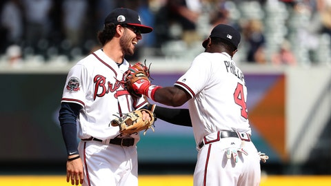 Apr 16, 2017; Atlanta, GA, USA; Atlanta Braves shortstop Dansby Swanson (7) celebrates with second baseman Brandon Phillips (4) after their win against the San Diego Padres at SunTrust Park. The Braves won 9-2. Mandatory Credit: Jason Getz-USA TODAY Sports
