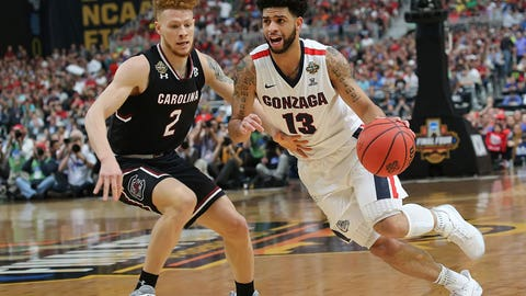 Gonzaga's Josh Perkins drives against South Carolina's GHassani Gravett.