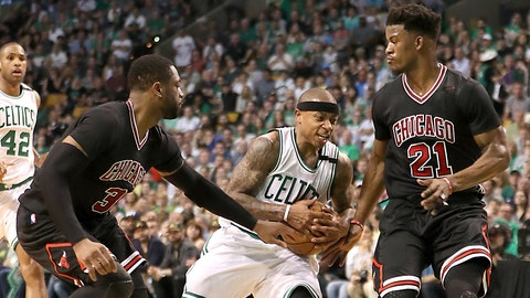 BOSTON - APRIL 16: Boston Celtics player Isaiah Thomas runs into defensive pressure from Chicago Bulls players Dwayne Wade (left) and Jimmy Butler during second quarter action of the first round of the NBA Playoffs at TD Garden in Boston on April 16, 2017. (Photo by Matthew J. Lee/The Boston Globe via Getty Images)