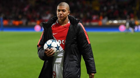 MONACO - APRIL 19:  Kylian Mbappe of AS Monaco celebrates victory at the end of the UEFA Champions League Quarter Final second leg match between AS Monaco and Borussia Dortmund at Stade Louis II on April 19, 2017 in Monaco, Monaco.  (Photo by Valerio Pennicino - UEFA/UEFA via Getty Images)