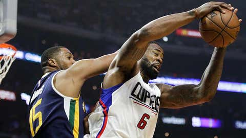 Los Angeles Clippers' DeAndre Jordan, right, gets a rebound against Utah Jazz's Derrick Favors during the first half in Game 2 of an NBA basketball first-round playoff series Tuesday, April 18, 2017, in Los Angeles. (AP Photo/Jae C. Hong)