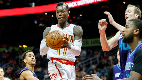 Apr 11, 2017; Atlanta, GA, USA; Atlanta Hawks guard Dennis Schroder (17) passes the ball against the Charlotte Hornets in the third quarter at Philips Arena. The Hawks defeated the Hornets 103-76. Mandatory Credit: Brett Davis-USA TODAY Sports