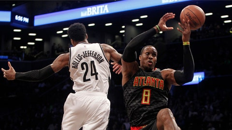 Apr 2, 2017; Brooklyn, NY, USA; Brooklyn Nets guard Rondae Hollis-Jefferson (24) rebounds against Atlanta Hawks center Dwight Howard (8) in the third quarter at Barclays Center. The Nets won 91-82. Mandatory Credit: Nicole Sweet-USA TODAY Sports