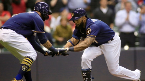 Milwaukee Brewers first baseman Eric Thames, right, is congratulated by Jonathan Villar, left, after hitting a two run home run against the St. Louis Cardinals during the fifth inning of an baseball game Thursday, April 20, 2017, in Milwaukee. (AP Photo/Darren Hauck)