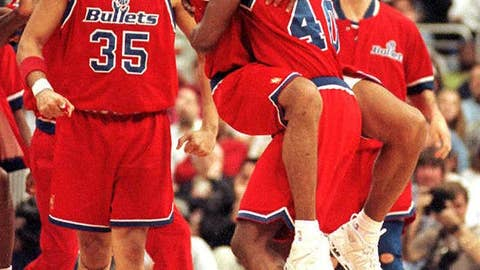 Calbert Cheaney and Juwan Howard celebrate playoff berth
