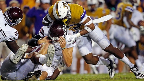 Mississippi State quarterback Nick Fitzgerald (7) is stopped on a carry by LSU safety Jamal Adams (33) in the first half of an NCAA college football game in Baton Rouge, La., Saturday, Sept. 17, 2016. (AP Photo/Gerald Herbert)