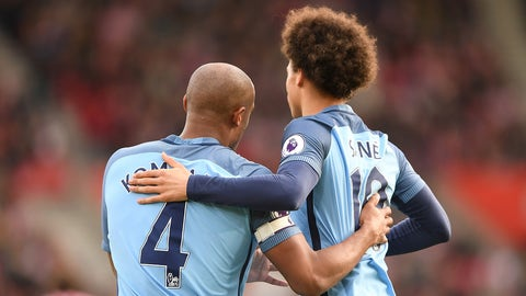 SOUTHAMPTON, ENGLAND - APRIL 15: Vincent Kompany of Manchester City celebrates scoring his sides first goal with Leroy Sane of Manchester City during the Premier League match between Southampton and Manchester City at St Mary's Stadium on April 15, 2017 in Southampton, England.  (Photo by Mike Hewitt/Getty Images)