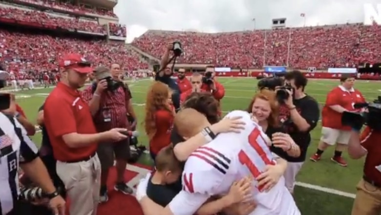 Watch: Military dad surprises family with Nebraska football player disguise