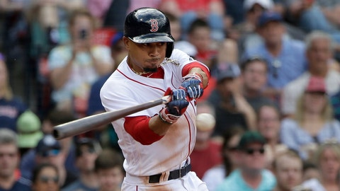 Boston Red Sox's Mookie Betts swings at a pitch in the seventh inning of a baseball game against the Tampa Bay Rays, Sunday, April 16, 2017, in Boston. (AP Photo/Steven Senne)