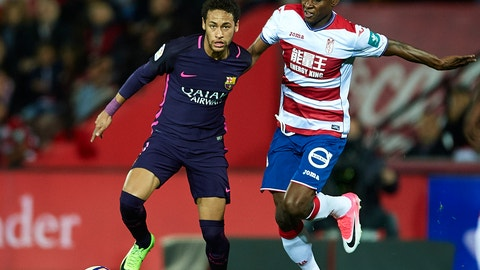 GRANADA, SPAIN - APRIL 02:  Neymar Jr of FC Barcelona (L) competes for the ball with Uche Henry Agbo of Granada CF (R) during the La Liga match between Granada CF v FC Barcelona at Estadio Nuevo Los Carmenes on April 02, 2017 in Granada, Spain.  (Photo by Aitor Alcalde/Getty Images)