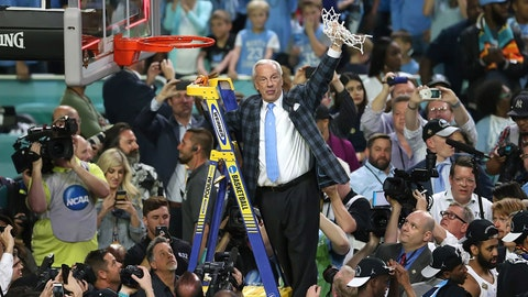 Roy Williams cuts down the net.