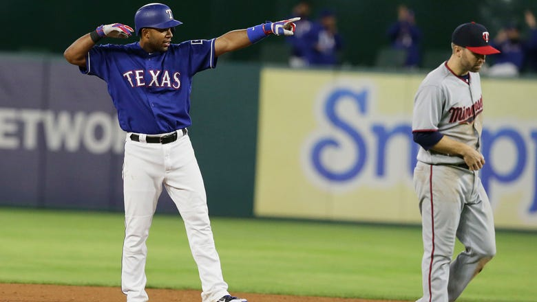 Rangers use eight-run 8th inning to beat Twins