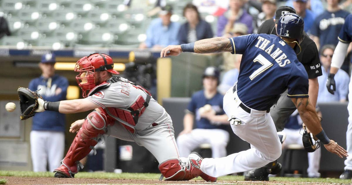Pi-fsw-brewers-mlb-eric-thames-slide-reds-042617.vresize.1200.630.high.0