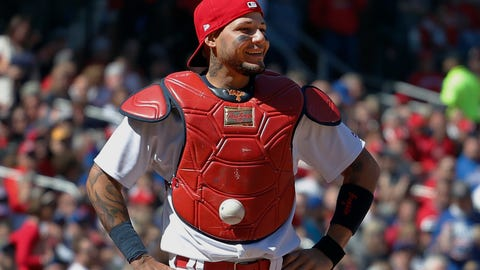 Major League Baseball catcher Yadier Molina gets ball stuck in his chest protector