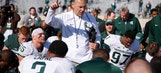 Spartans hold spring game under cloud of investigation