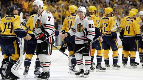 Chicago Blackhawks defenseman Brent Seabrook (7) and right wing Patrick Kane (88) shake hands with Nashville Predators after Game 4 of a first-round NHL hockey playoff series Thursday, April 20, 2017, in Nashville, Tenn. The Predators won 4-1 to sweep the series. (AP Photo/Mark Humphrey)