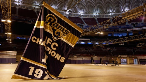FILE - In this Jan. 14, 2016, file photo, championship banners are removed from the Edward Jones Dome, former home of the St. Louis Rams football team in St. Louis. The city of St. Louis and that region's sports authority are suing the National Football League over the Rams' relocation to Los Angeles. The lawsuit filed Wednesday, April 12, 2017, in St. Louis Circuit Court also names the NFL's 32 teams as defendants and seeks unspecified damages and restitution.(AP Photo/Jeff Roberson, File)
