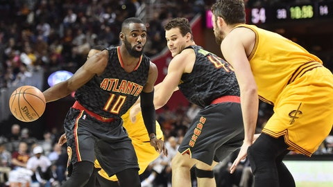 Apr 7, 2017; Cleveland, OH, USA; Atlanta Hawks guard Tim Hardaway Jr. (10) drives to the basket against Cleveland Cavaliers forward Kevin Love (0) during the second half at Quicken Loans Arena. The Hawks won 114-100. Mandatory Credit: Ken Blaze-USA TODAY Sports