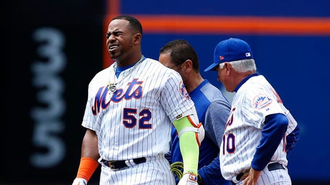 Apr 27, 2017; New York City, NY, USA;  New York Mets left fielder Yoenis Cespedes (52) reacts after an injury in the fourth inning against the Atlanta Braves at Citi Field. Mandatory Credit: Noah K. Murray-USA TODAY Sports